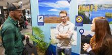 3 people at the LINZ Fieldays stand