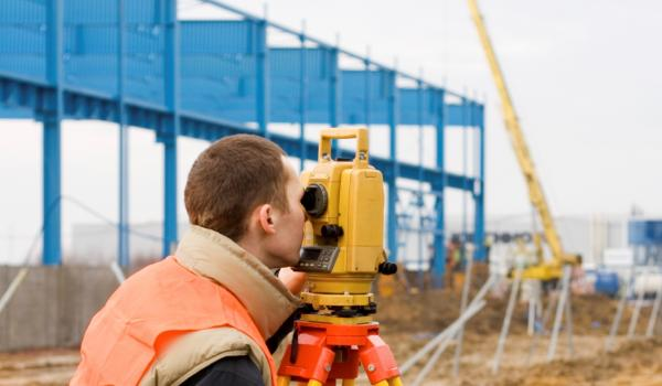 Surveyor on a commercial building site
